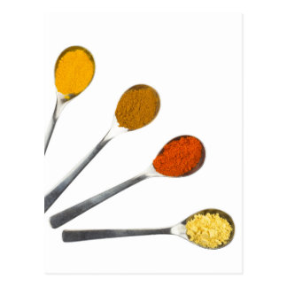 Five seasoning spices on metal spoons postcard