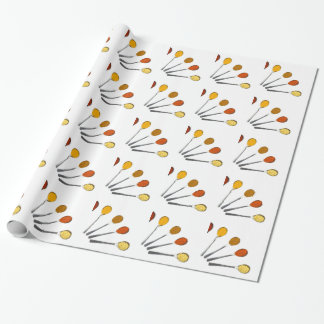 Five seasoning spices on metal spoons wrapping paper