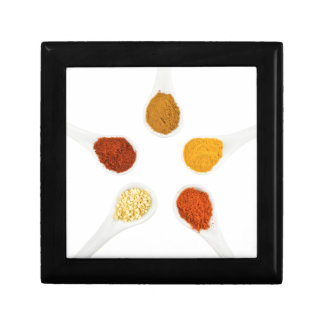 Five seasoning spices on porcelain spoons gift box