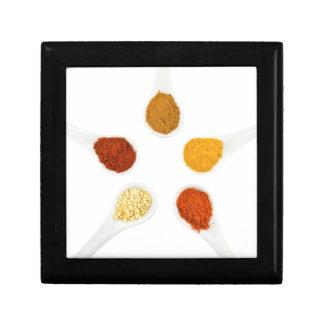 Five seasoning spices on porcelain spoons keepsake boxes
