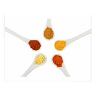 Five seasoning spices on porcelain spoons postcard