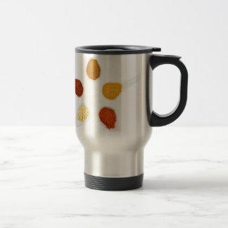 Five seasoning spices on porcelain spoons travel mug