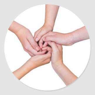 Five teenage arms with hands entangled round sticker