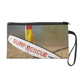 Flags and surf rescue board wristlet purse
