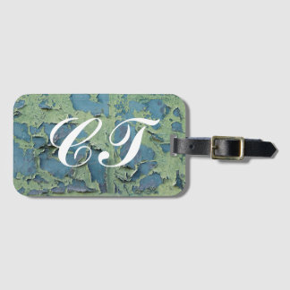 Flaked paint weathered initial luggage tag
