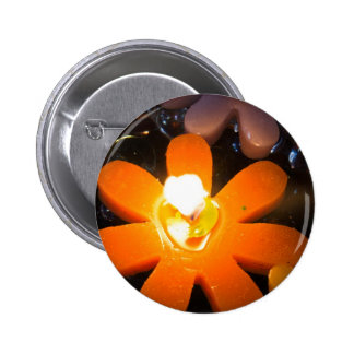 Flame from an orange floating candle button