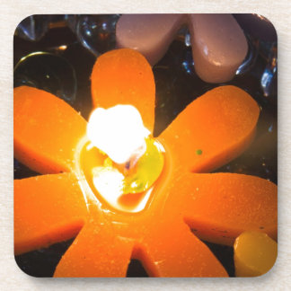 Flame from an orange floating candle beverage coasters
