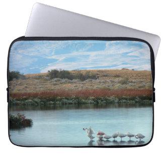 Flamingos at dusk laptop sleeves