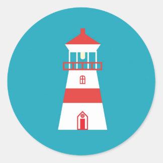 Flat lighthouse on turquoise background round sticker
