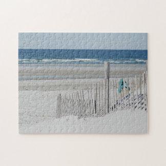 Flip flops on the beach fence jigsaw puzzle