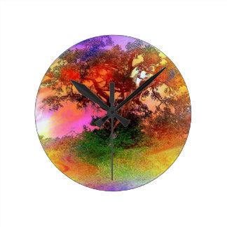 Floating black tree on rainbow foggy background wallclock