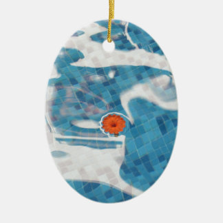 Floating Orange Spring  Flower in Blue Water Ceramic Oval Ornament