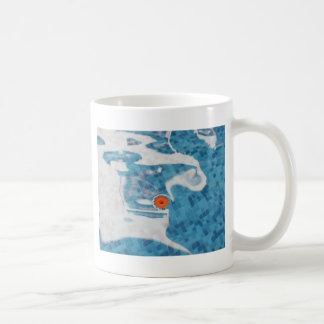 Floating Orange Spring  Flower in Blue Water Coffee Mug