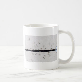 Flock of mosquitoes that enter the room coffee mug