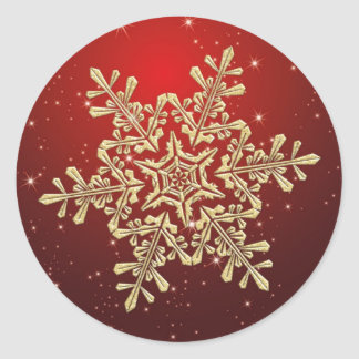 Flocon de neige d'or sur l'autocollant rouge de