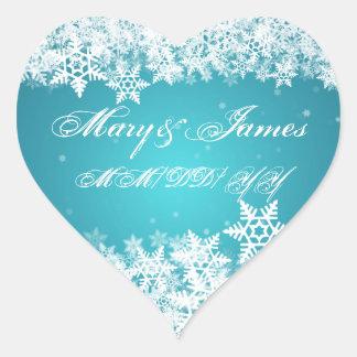 Flocons de neige élégants d'hiver de date de autocollant en cœur