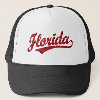 Florida script logo in red trucker hat
