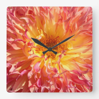flouncy dahlia in yellow and pink square wall clock