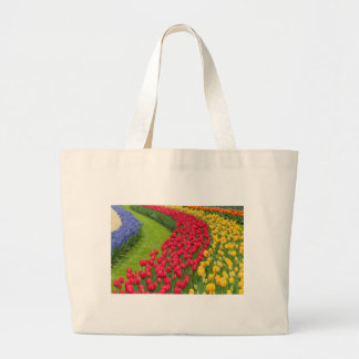 Flower beds of multicolored tulips large tote bag