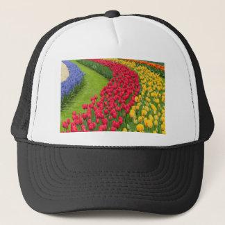 Flower beds of multicolored tulips trucker hat