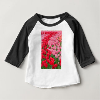 Flower beds of red and pink tulips baby T-Shirt