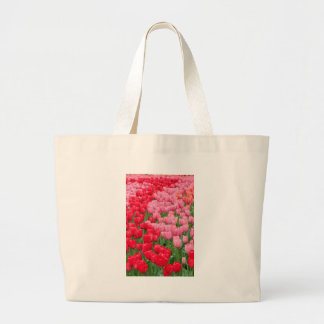 Flower beds of red and pink tulips large tote bag