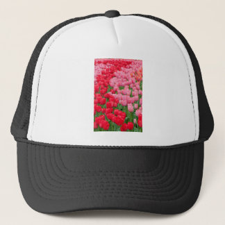 Flower beds of red and pink tulips trucker hat