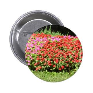 Flower Garden of Pink & Red Flowers Next to Grass Button