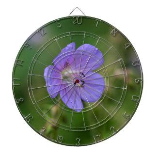 Flower of a meadow geranium dartboard with darts