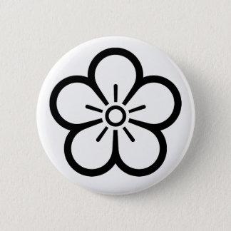 Flower of medium shade plum 2 inch round button