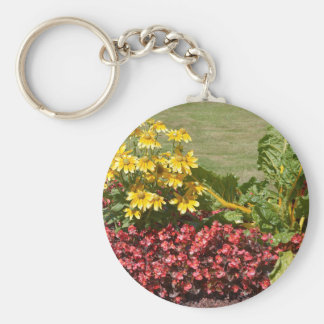 Flowerbed of coneflowers and begonias keychain