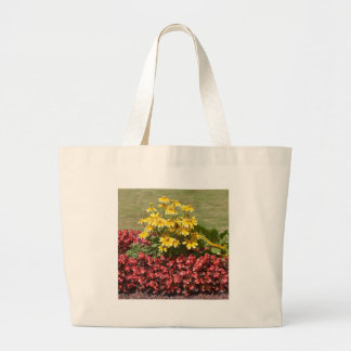Flowerbed of coneflowers and begonias large tote bag