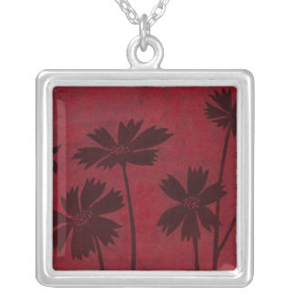 Flowerhead Silhouettes on Crimson Background Silver Plated Necklace
