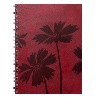 Flowerhead Silhouettes on Crimson Background Spiral Note Books