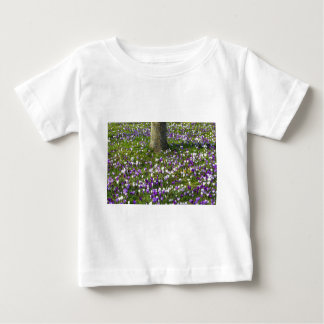 Flowers field crocuses in spring grass with tree baby T-Shirt