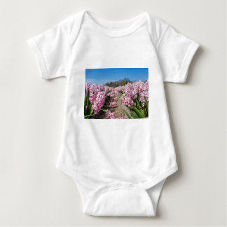 Flowers field with pink hyacinths in Holland Baby Bodysuit