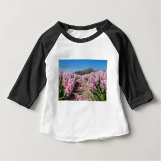 Flowers field with pink hyacinths in Holland Baby T-Shirt