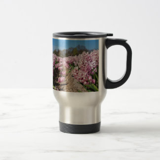 Flowers field with pink hyacinths in Holland Travel Mug