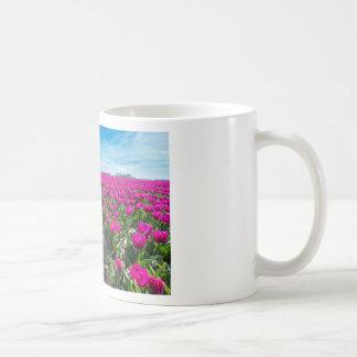 Flowers field with purple tulips and path coffee mug