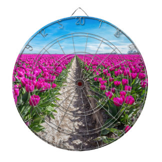 Flowers field with purple tulips and path dartboard
