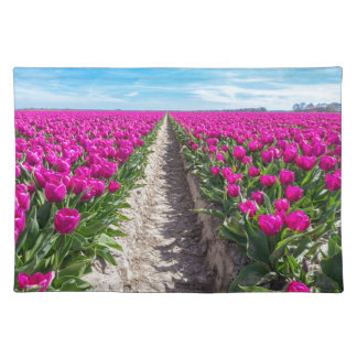 Flowers field with purple tulips and path placemat