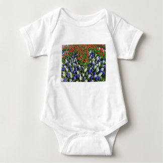 Flowers field with red blue tulips and hyacinths baby bodysuit