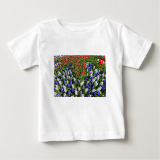 Flowers field with red blue tulips and hyacinths baby T-Shirt