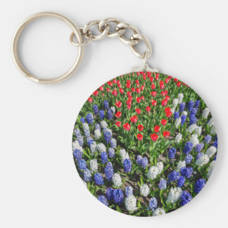 Flowers field with red blue tulips and hyacinths basic round button keychain