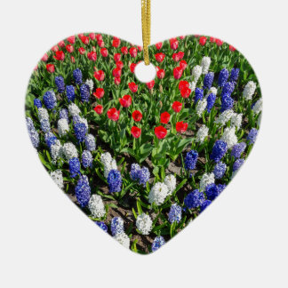 Flowers field with red blue tulips and hyacinths ceramic heart ornament