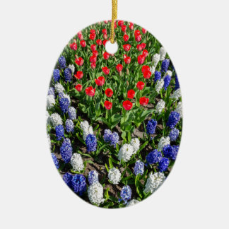 Flowers field with red blue tulips and hyacinths ceramic ornament
