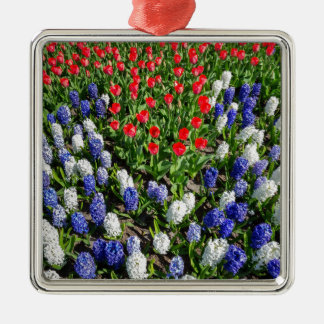 Flowers field with red blue tulips and hyacinths metal ornament