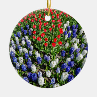 Flowers field with red blue tulips and hyacinths round ceramic ornament