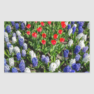 Flowers field with red blue tulips and hyacinths sticker