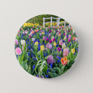 Flowers field with tulips hyacinths and bridge 2 inch round button